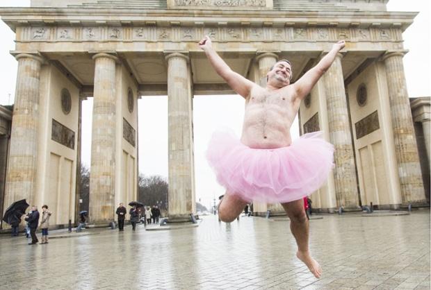 Bob Carey dressed in a pink tutu in front of the Brandenburg Gate, Berlin, Germany - 09 Dec 2013